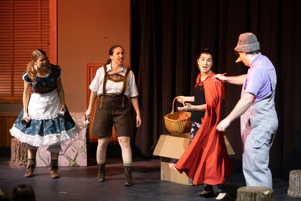 """(L-R) Gretel (played by Samantha Bell), Hansel (Natalie Buckley), Red Riding Hood (Safia Comtois-Mohamed) and Pinocchio (Daniel Rose) break down into bickering on the playground in  """"The Fellowship of the Swing"""" at the Rotary Performing Arts Centre on Nov. 30. The children's play was produced by Goodger-Pink Family Theatre. (BRENT CALVER/Western Wheel)"""