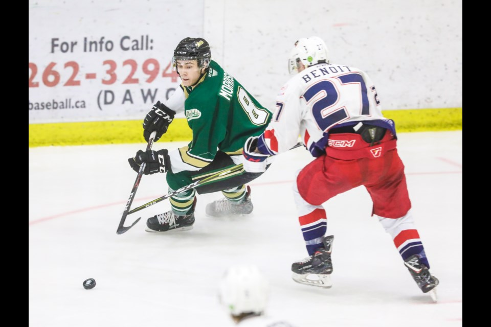 Okotoks Oilers forward Brayden Morrison is dogged by Brooks Bandits forward Marc-Antoine Benoit at Pason Centennial Arena on Jan. 3.  The Oilers' 4-3 win marked an upset to Brooks month-long winning streak and only their second loss of the regular season. (Brent Calver/Western Wheel)