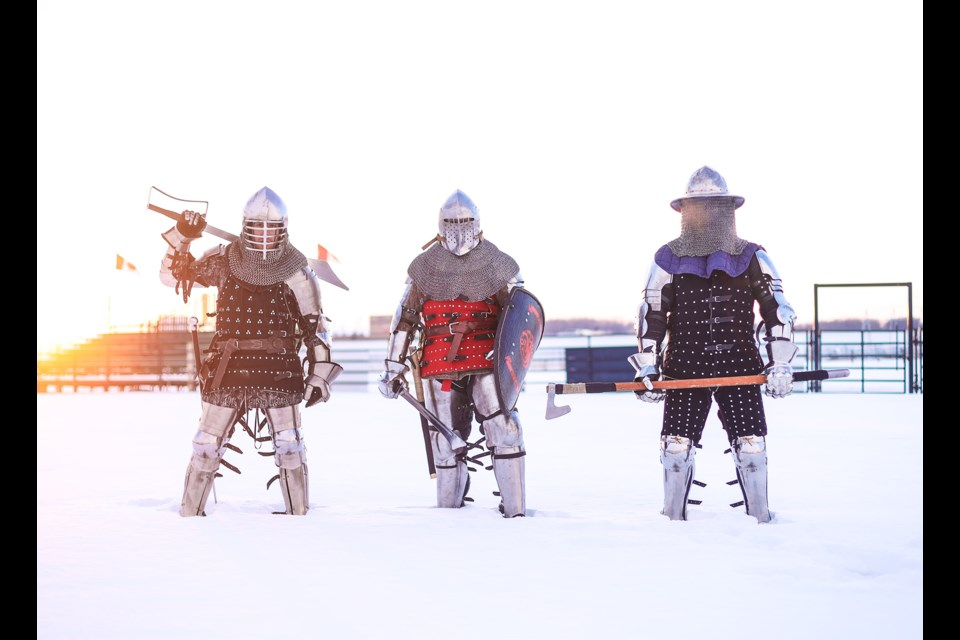 (L-R) Richard Manns, Dave Greyland, and Ryan Neilson, members of the Heavy Armored Combat Society of Alberta (HACSA), pose for a photo on Jan. 11 at the Okotoks Agricultural Society. The group will be holding the Medieval Combat Winter Cup in the Ag Society arena on Jan. 18-19. (Brent Calver/Western Wheel)