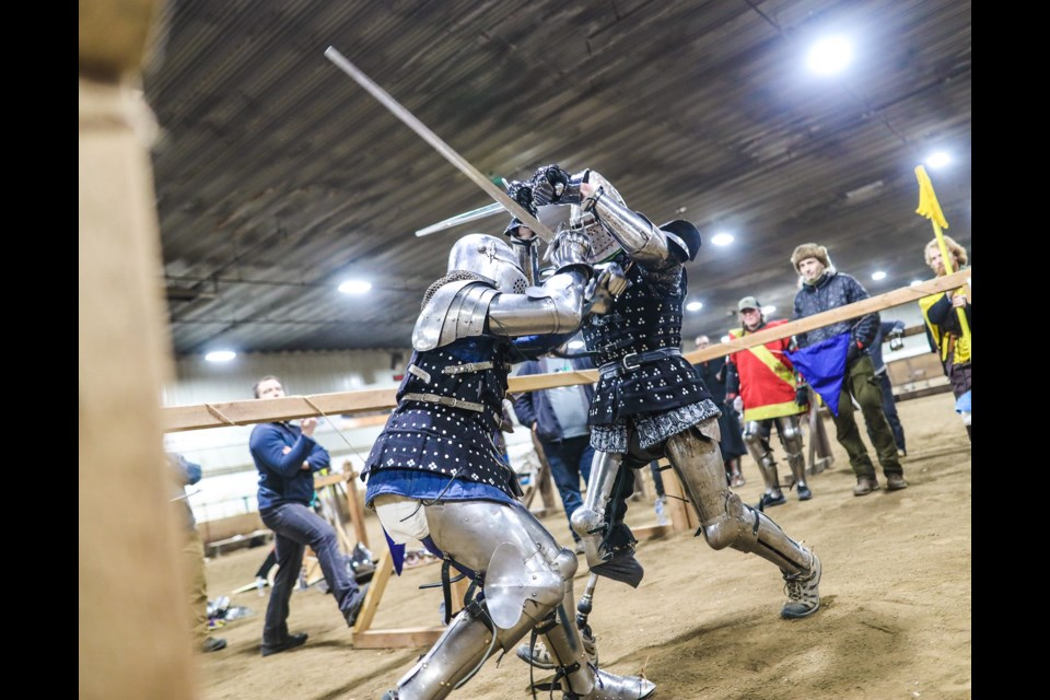 Steven Pearson (L) and Don Hornby duel during the Heavy Armored Combat Sports Association (HACSA) Winter Cup competition at the Okotoks Ag Society on Jan. 18. (Brent Calver/Western Wheel)