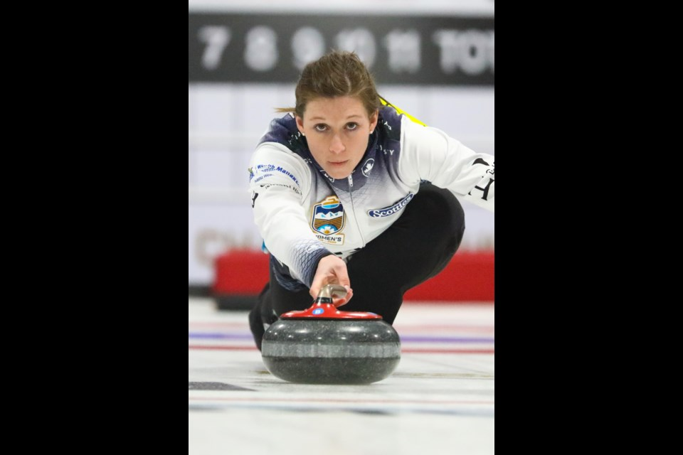 Team Rocque second Becca Hebert throws a rock during fourth draw of the 2020 Sentinel Storage Alberta Scotties Tournament of Hearts at the Murray Arena in Okotoks on Jan. 23. (Evan Buhler/Western Wheel)