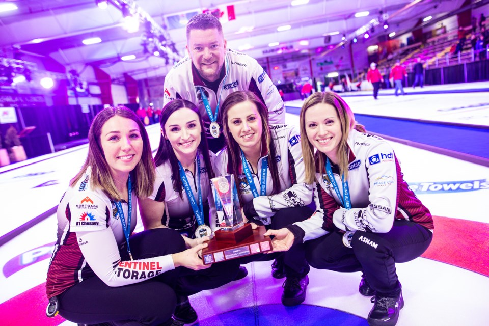 Team Walker lead Nadine Scotland, second Taylor McDonald, third Kate Cameron, skip Laura Walker and coach Brian Chick sport their gold medals and trophy after winning the 2020 Alberta Scotties Tournament of Hearts at Murray Arena on Jan. 26. (Brent Calver/Western Wheel)