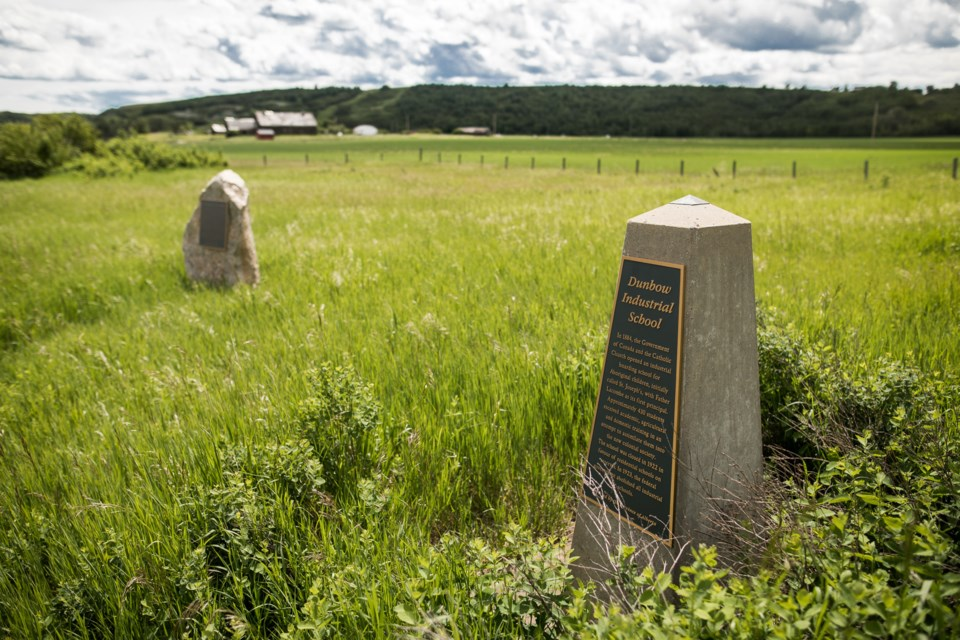 Two memorial plaques serve as some of the only remaining signs of the Dunbow Industrial School (also known as St. Joseph's Industrial School) north of Okotoks which operated from 1884 to 1922. (Brent Calver/Western Wheel File Photo)