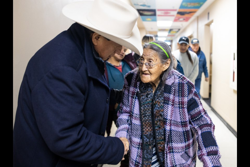 Recently re-elected Bearspaw Nation Chief Darcy Dixon greets elder Eileen Lefthand during the inauguration of the Bearspaw Nation Band Council on Jan. 10, 2019 at Chief Jacob Bearspaw Memorial School in Eden Valley. BRENT CALVER WESTERN WHEEL PHOTO