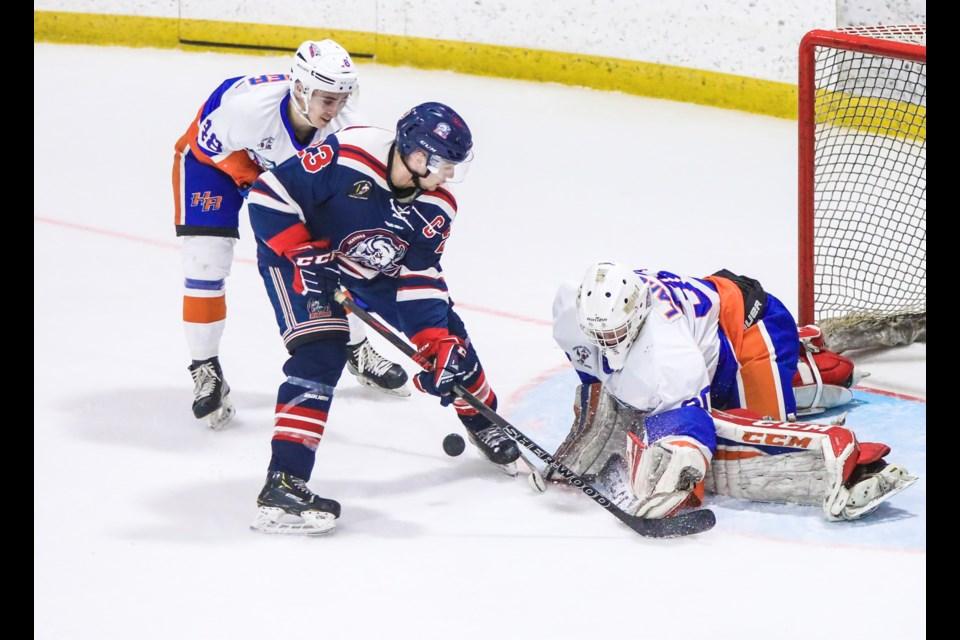 High River Flyers goaltender Davyn LaRocke blocks a shot by Okotoks Bisons forward Tyler Witzke at Murray Arena on Feb. 7. (Brent Calver/Western Wheel)