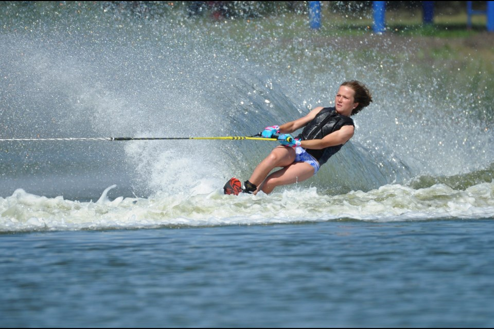 Megan Pelkey navigates through buoys in the slalom portion of water-skiing. (David Crowder Photo)