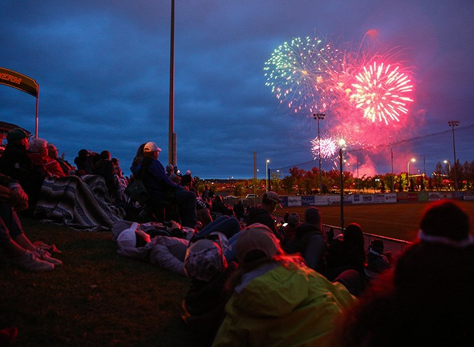 Attendees watch the Canada Day fireworks after the Dawgs game at Seaman Stadium on July 1. (Devon Langille/Western Wheel)
