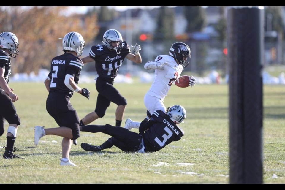 Foothills Falcon Eton Nelson scores the team's third touchdown in the 27-14 win over Centennial on Oct. 4 in Okotoks. (Brent Calver/Western Wheel)