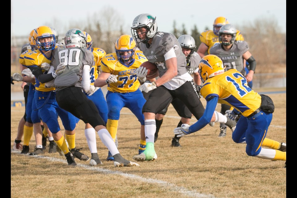 Holy Trinity Academy Knight Noah Gutek runs in his first of two touchdowns during the 35-22 win over the Bert Church Chargers in the South region final on Nov. 16 at Ed Eggerer Athletic Park in Airdrie. (Remy Greer/Western Wheel)
