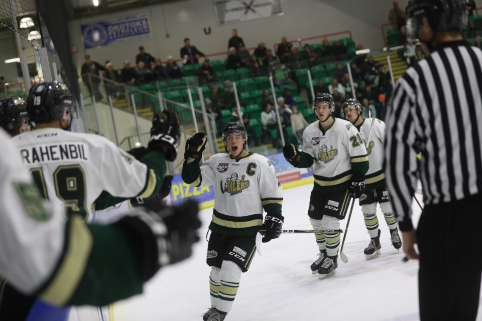 Okotoks Oilers defenceman Ayden Roche-Setoguchi celebrates the team's second goal in the 3-2 win over the Sherwoood Park Crusaders on Oct. 5 at Pason Centennial Arena.