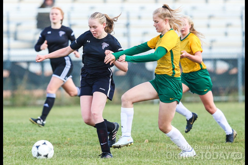 Foothills Falcons striker Amanda Mitchell dribbles against the Canmore Crusaders during Foothills' 8-0 win in FAC girls soccer action on Sept. 26 at Falcons field. (BRENT CALVER/Western Wheel)