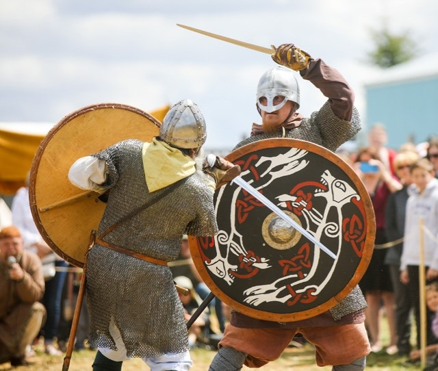 """Nick Goetz and Christian Arel clash swords on the """"battlefield"""" in the Viking Village at Chinook Honey's Horde at the Hive event last year. This"""