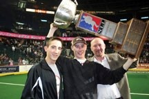 Brad Banister celebrates the Calgary Roughnecks' 2009 championship with sons Raymond and Mitch. Banister has put the Roughnecks up for sale.