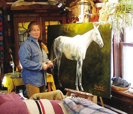 Foothills artist Jan Roenisch takes a step back while working on a painting of a horse named Blue Duck. Many of her animal paintings are now on display at the Longview