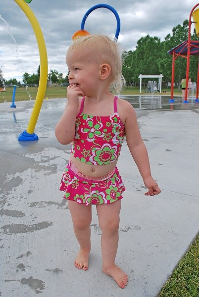 Two-year-old Keanna Young plays in the Okotoks Spray Park in 2011. The Foothills Lions Club Family Spray Park Committee hopes to have a similar park operating in Turner