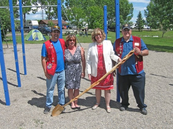 From the left, Foothills Lions Club Family Spray Park Committee chairman Barry Crane, Turner Valley Mayor Kelly Tuck, Calgary-Glenmore MLA Linda Johnson and Foothills Lions