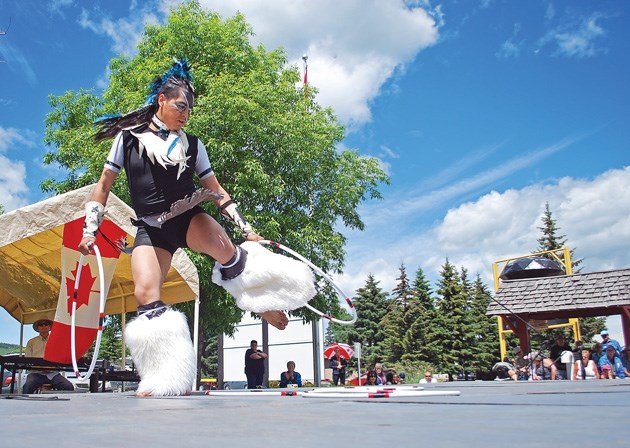 This dancer with the First Nations International Dancers Co. puts on a show for Diamond Valley and area residents during Black Diamond' s Canada Day celebrations in a