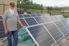 Dusty Williams, Town of Turner Valley environmental services and recycle supervisor, stands beside the solar array system near the Town' s water treatment plant last