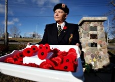 Linda Macaulay, poppy chairman and first vice-president of the Royal Canadian Legion Turner Valley Branch, holds a box of poppies. The legion kicks off its poppy fundraising