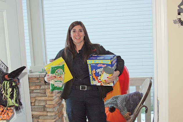 Black Diamond firefighter Jamie Kline is one of many firefighters going door to door in Black Diamond, Turner Valley and Longview on Nov. 3 and 4 to collect food and cash