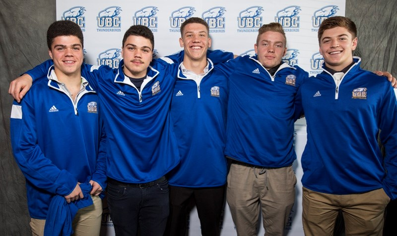 A quartet of Foothills area high school football players signed with the UBC Thunderbirds Friday. They are, from left, Priddis' Michael and Christian Sherman, Foothills