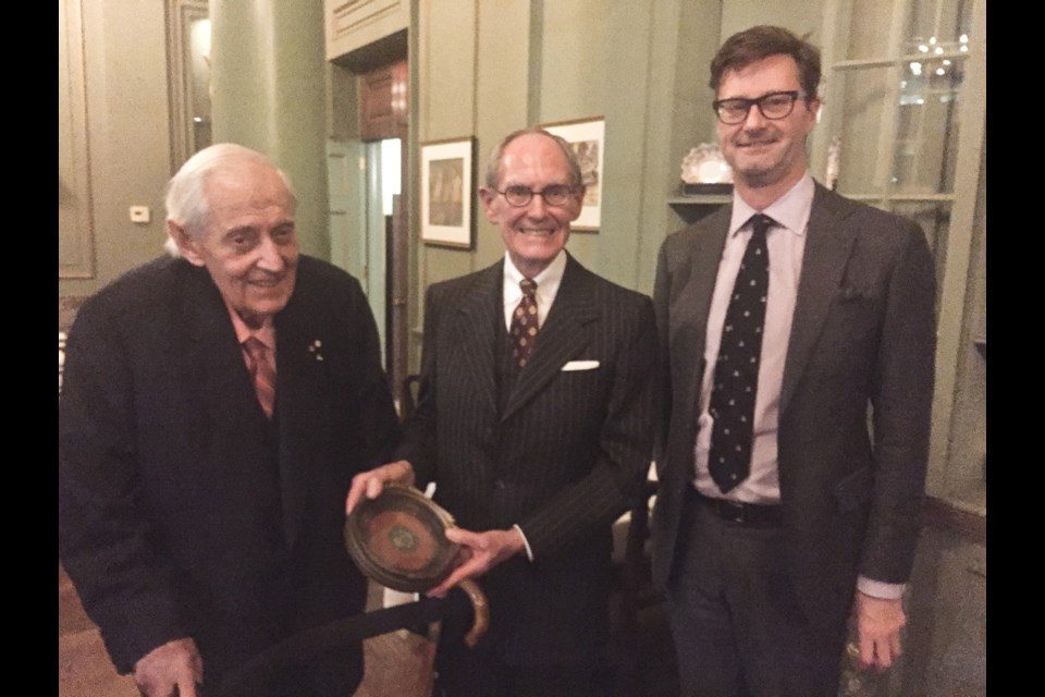 Thomas Symons, left, presents the Stephen Leacock Medal for Humour won by his father, Harry Symons, in 1947 to University Club of Toronto president D. Ross Peebles, centre, and Neil Guthrie, a member of the club's art committee. It was the first Leacock Medal that was awarded. Supplied photo