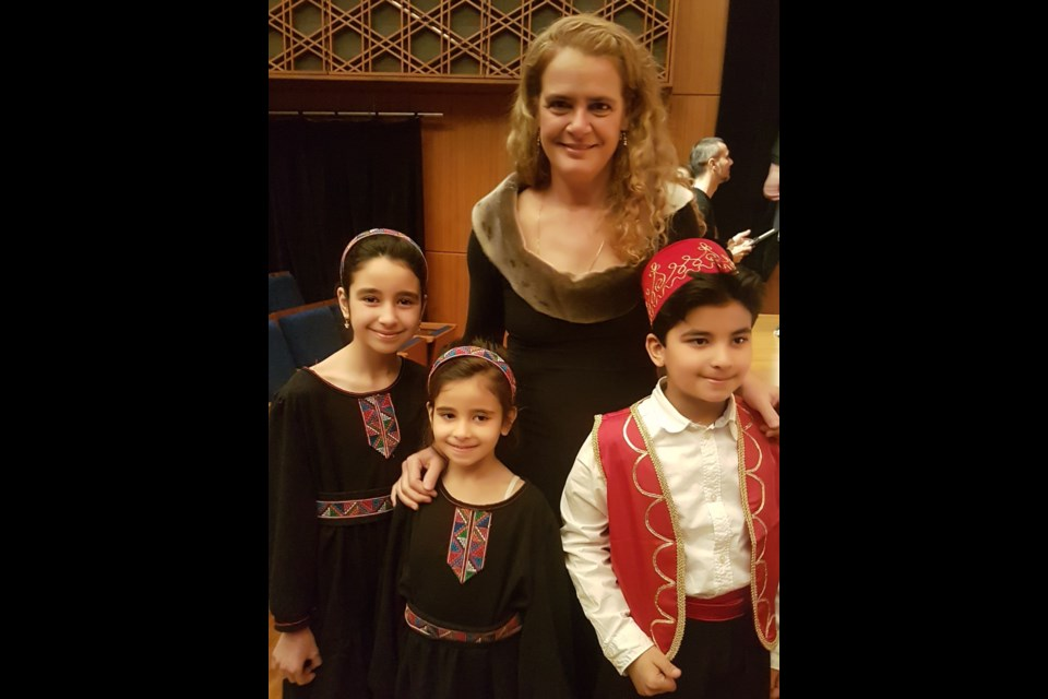 Governor-General Julie Payette is shown with three members of the Nai Children's Choir, which will perform in Orillia, with the Orillia Vocal Ensemble, Feb.24.