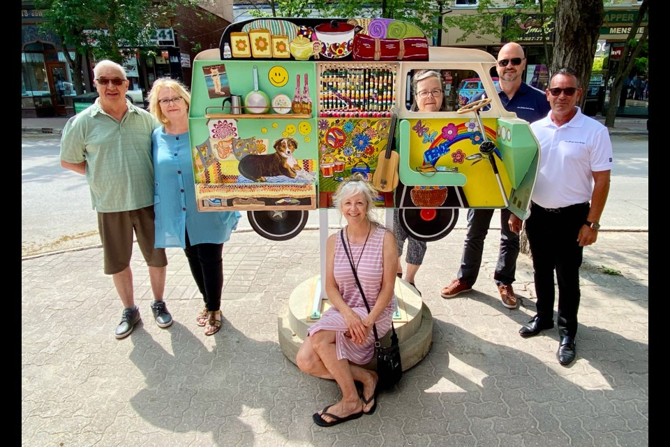 Plaza Auto Group's Orillia Volkswagen is the presenting sponsor of this year's Streets Alive hippie van project. Shown with the sculpture sponsored by Orillia Volkswagen are the artists, Normand and Susan Quintal, left, Streets Alive founder Leslie Fournier, seated, Christine Hager, board secretary with the Orillia and District Arts Council, Orillia Volkswagen general manager Colin Koprowski, second from right, and Plaza Auto Group president Robert Stein.