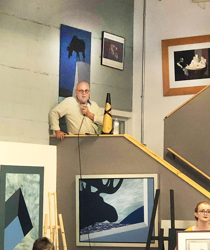 Charles Pachter on the mic at a previous in person auction 2018