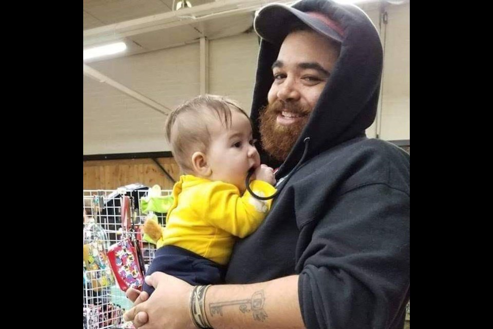 Chris Edwards, shown with his baby, has won the right to be the featured artist at next summer's Steampunk Festival in Coldwater. Supplied photo