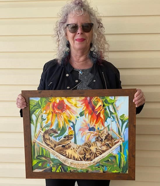 Local artist Manuela Maurus recently raffled off her artwork in a fundraiser for The Comfie Cat Shelter.