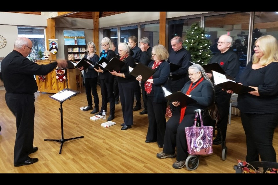 Roy Menagh leads the Orillia Vocal Ensemble Chamber Choir as they performed some early holiday music at Trillium Manor this week. Contributed photo