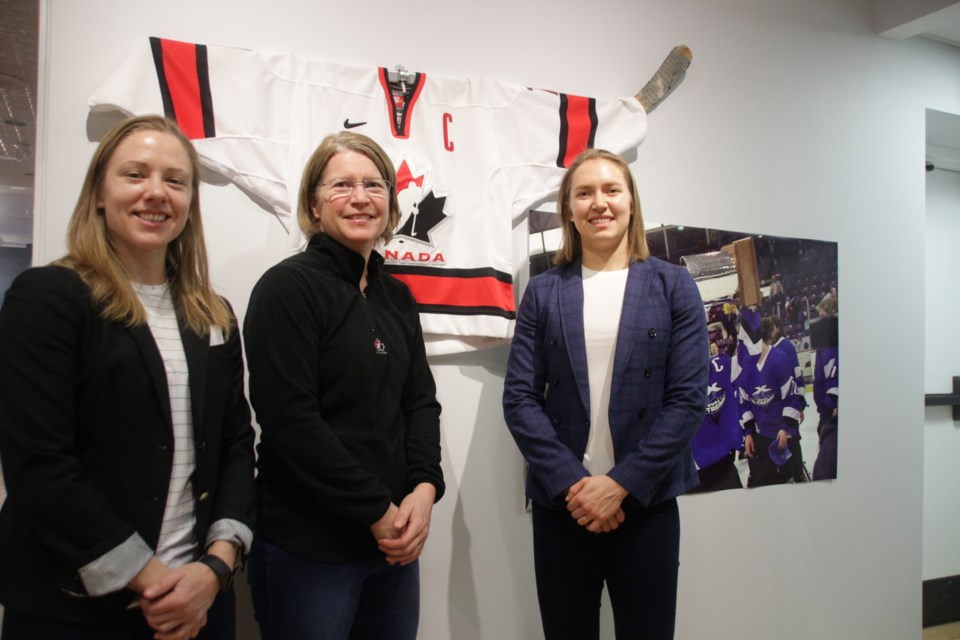 Big names in women's hockey were front and centre at the opening of the exhibit She Shoots…She Scores Saturday at the Orillia Museum of Art and History. From left, Liz Knox, board member, Professional Women's Hockey Players Association and former Markham Thunder player, Nathalie Rivard, former Team Canada player, and Brianne Jenner, current Team Canada and Calgary Inferno player. Mehreen Shahid/OrilliaMatters