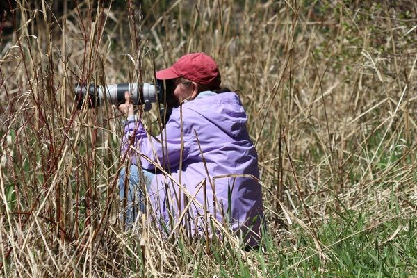 Deb Halbot pursuing her passion as a nature photographer.