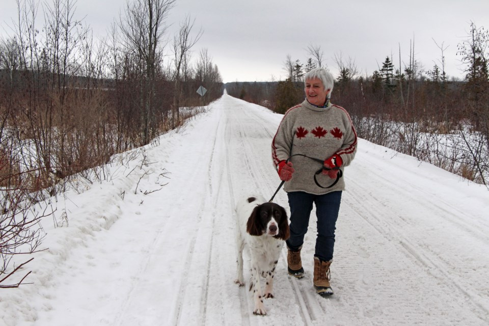 One of Lynn Jamieson's favourite places to walk her dog, Elmo, is along the Oro-Medonte rail trail. Photo by Kathy Hunt