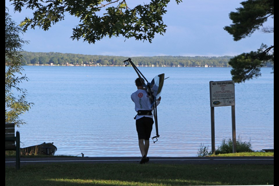 Max Woodward launches his single for a rowing workout at the Orillia Rowing Club. The club is offering 'try out rowing' and 'learn to row' programs. Kathy Hunt/OrilliaMatters File Photo
