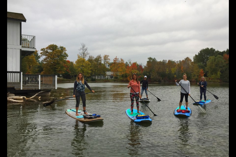 A group of stand up paddlers about to begin a tour with guide Rosanna Shillolo (far left) on Thanksgiving weekend, marking the end of the paddling season for Sunrise Yoga Studio. Kathy Hunt/OrilliaMatters