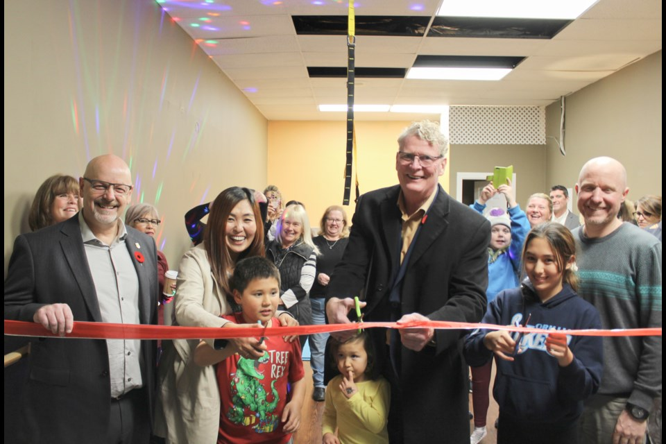 YJDanceFit held its grand opening at its new location on Atherley Road on Thursday. Helping to cut the ribbon were Coun. David Campbell, left, owner YJ Hong-McParland, second from left, and Mayor Steve Clarke. Nathan Taylor/OrilliaMatters