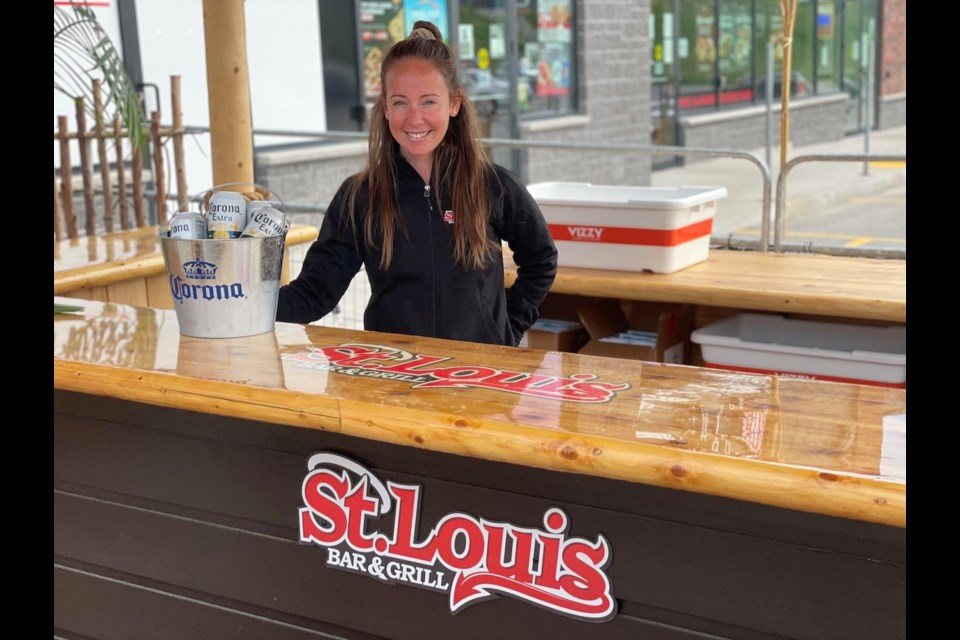 St. Louis Bar and Grill part-owner Shelby Tanzer is excited to welcome customers back to the restaurant and its new tiki oasis patio on Friday.