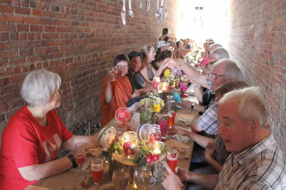 Dozens showed up to dine in a downtown Orillia alley during Saturday's Common Ground dinner hosted by Eclectic Café. Nathan Taylor/OrilliaMatters