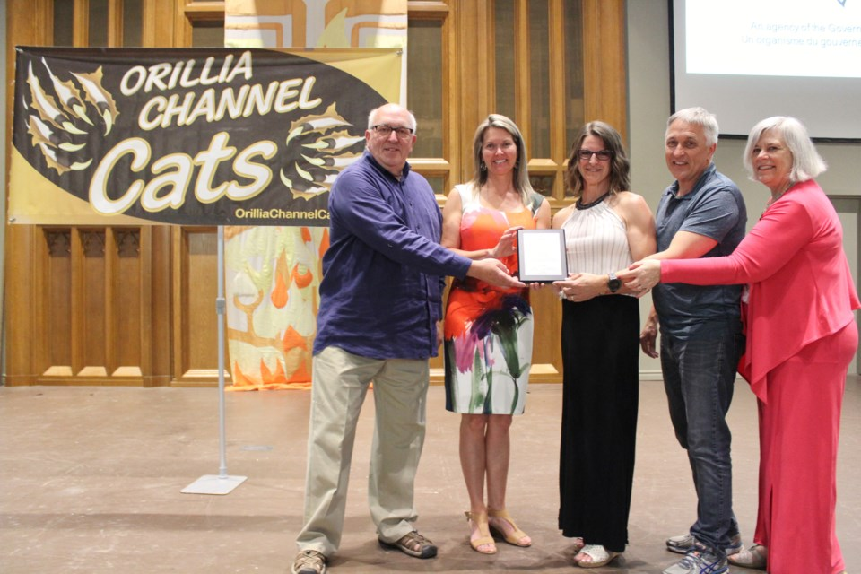 The Orillia Channel Cats Swim Club has received a $150,000 Ontario Trillium grant. On hand for a ceremony Tuesday at St. Paul's Centre were, from left, Ontario Trillium Foundation volunteer Allan Craig, Simcoe North MPP Jill Dunlop, Channel Cats head coach Meredith Thompson-Edwards, Channel Cats president Andre Widmer and Coun. Pat Hehn. Nathan Taylor/OrilliaMatters
