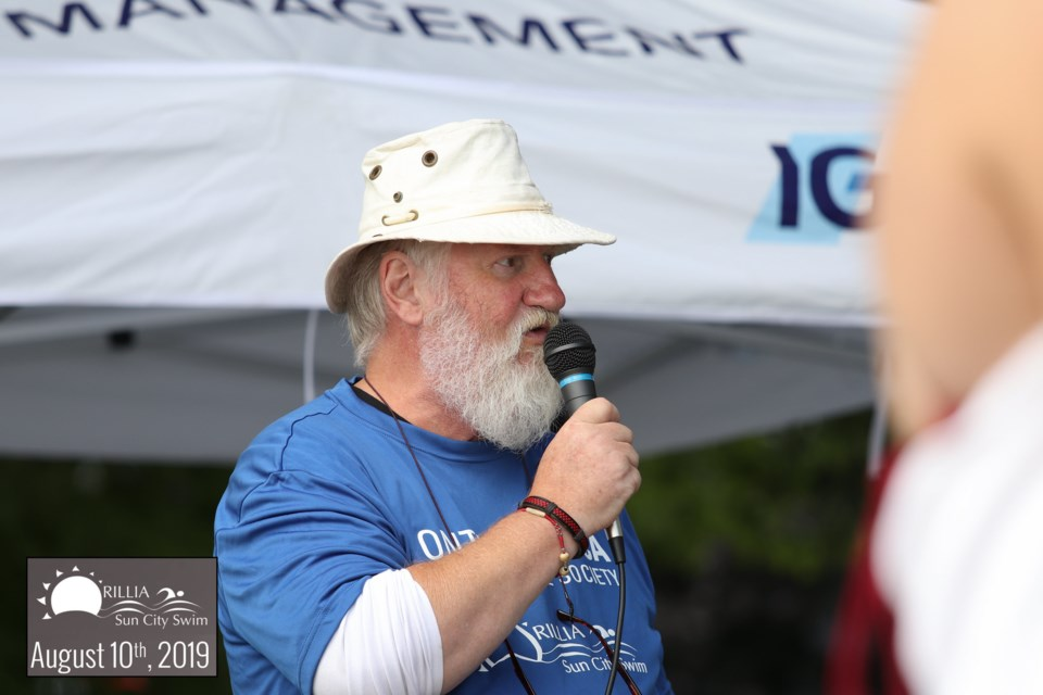 Tom Molloy, of the Ontario SPCA Orillia Animal Centre, speaks to the crowd at the 2019 Sun City Swim. This year's event will be a virtual event. Ron Jenkins/File Photo