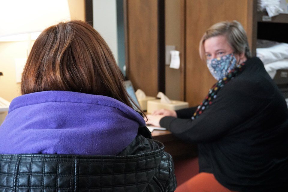 Genevieve Delcourt fills out a 2020 Simcoe County Homelessness Enumeration survey with shelter operations manager Trish Holloway. Jessica Owen/OrilliaMatters