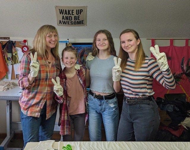 Wynnie, Mya and Ani Whalen-McKean are shown with their mom, Beth McKean. The family has created hand-made gloves to help stop the spread of the COVID-19 virus. Contributed photo