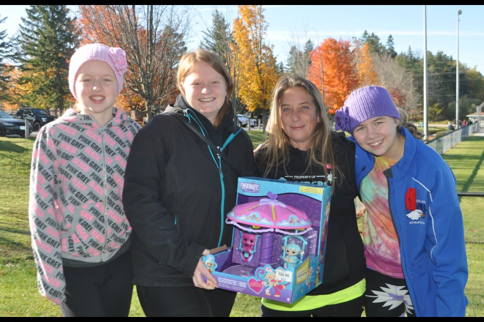 Bri-Allen Wilson, Keira Lebeuf, Tammy Lebeuf and Emma Mead all helped out at last year's Christmas Cheer baseball tournament. This year's event, slated for Saturday, has been cancelled due to pandemic restrictions. Andrew Philips/OrilliaMatters File Photo