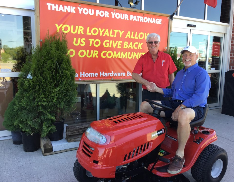 home hardware donates lawn mower to hillcrest