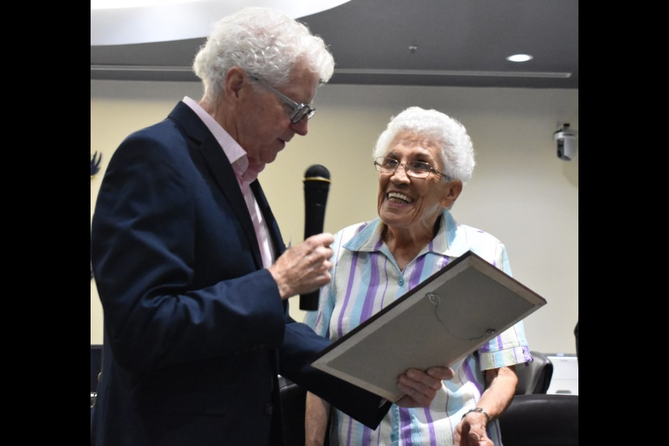 Alice Stamper was all smiles as Paul Raymond, the chair of Orillia's Commemorative Awards Committee, presented her with the Order of Orillia at a ceremoney in 2018. Stamper died this week. Dave Dawson/OrilliaMatters File Photo