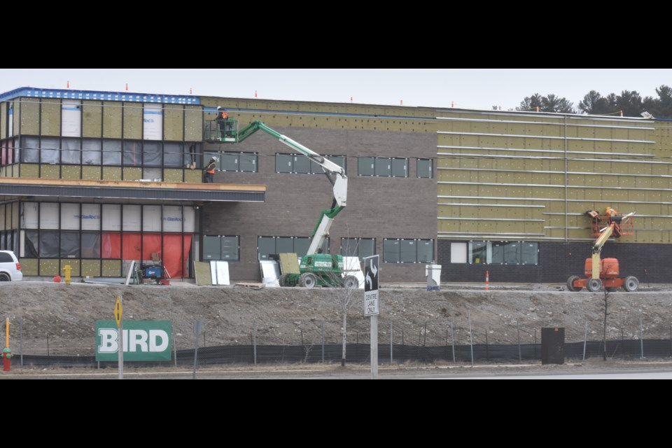 Despite a state of emergency and a shutdown of non-essential enterprises, construction continues as is evidenced by this ongoing work at the new Orillia OPP detachment. Workers were busy at the site Wednesday afternoon. Dave Dawson/OrilliaMatters