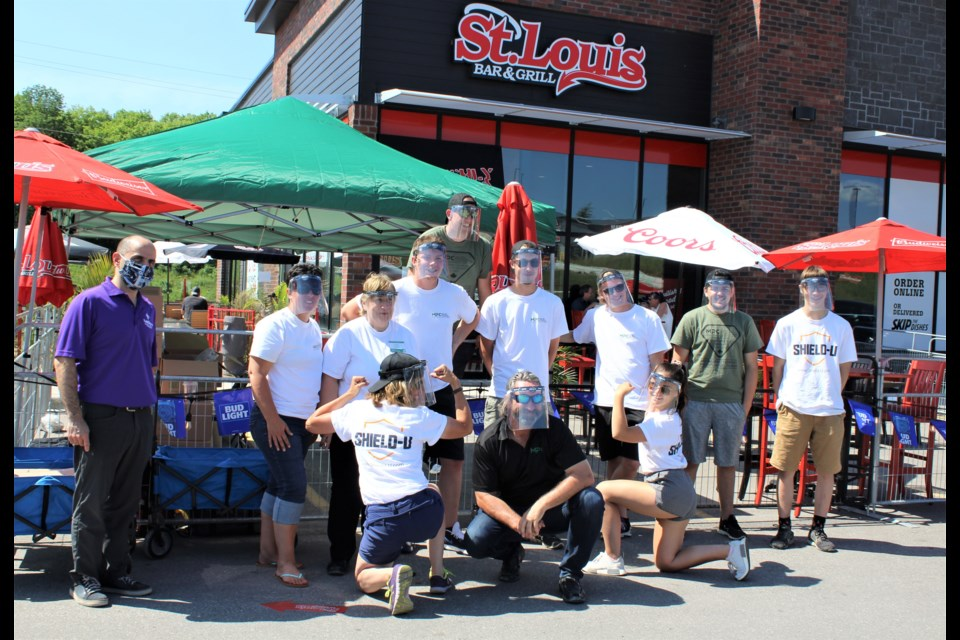 Members of the Molded Precision Components team are shown with Carmine Stumpo, left, president and CEO of Orillia Soldiers' Memorial Hospital, on Friday in front of St. Louis Bar and Grill, where the company was handing out face shields. Nathan Taylor/OrilliaMatters