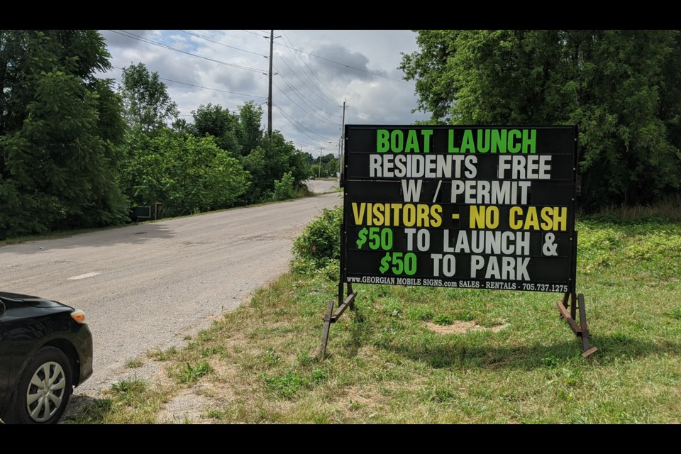 Multiple signs have been erected near local beach parking lots to let people know about the new restrictions that are in place from Thursday through Sundays until mid-September. The goal is to dissuade visitors from coming to the area during the pandemic. Dave Dawson/OrilliaMatters